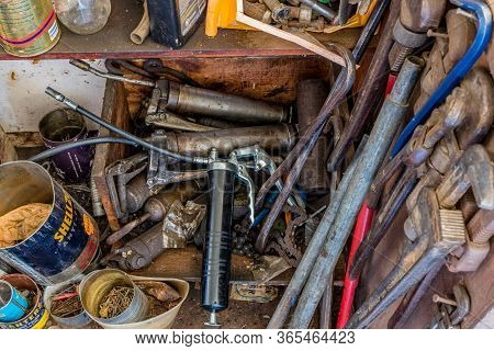 Swift Current, Sk/canada- May 1, 2020: A Collection Of Vintage Grease Guns, Pipe Wrenches And Variou