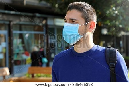 Covid-19 Social Distancing Man In City Street Wearing Surgical Mask Against Virus Sars-cov-2. Portra