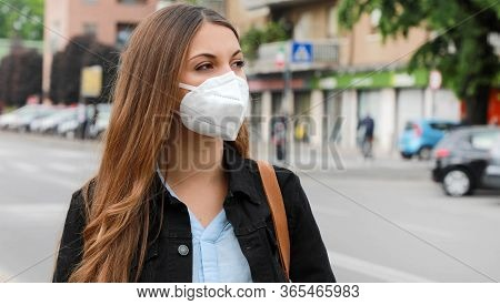 Covid-19 Pandemic Coronavirus Woman In City Street Wearing Kn95 Ffp2 Mask Protective For Spreading O