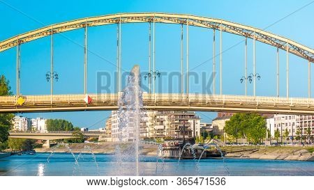 Nice Colorful Picture Of The Kossuth Bridge Over The Danube In Gyor. In The Foreground Is A Fountain