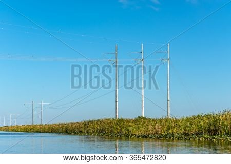 Power Lines Running Through Everglades National Park Near Fort Lauderdale, Florida, Usa - Electric P