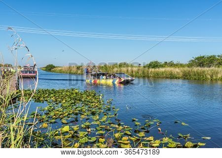 Everglades, United States Of America - April 27, 2019: Group Of Tourists Riding An Airboat. The Ever