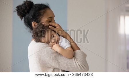 Caring Biracial Mom Hug Little Baby Toddler