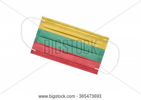 Medical Mask With Flag Of Lithuania Isolated On A White Background. The Concept Of The Pandemic In L
