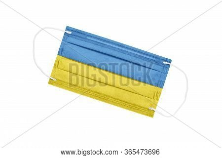 Medical Mask With The Flag Of Ukraine Isolated On White Background. The Concept Of A Pandemic In Ukr