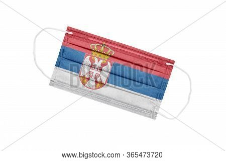 Medical Mask With Flag Of Serbia Isolated On White Background. The Concept Of A Pandemic In Serbia.