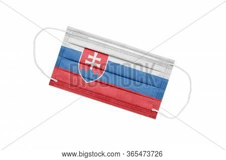 Medical Mask With Flag Of Slovakia Isolated On White Background. Slovakia Pandemic Concept. Coronavi