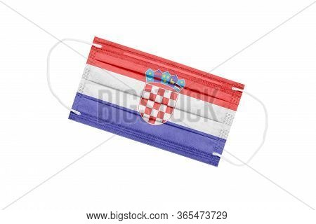 Medical Mask With Flag Of Croatia Isolated On White Background. Croatia Pandemic Concept. Coronaviru