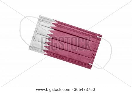 Medical Mask With Flag Of Qatar Isolated On White Background. Qatar Pandemic Concept. Attribute Of A
