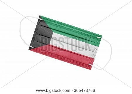Medical Mask With The Flag Of Kuwait Isolated On White Background. Kuwait Pandemic Concept. Attribut