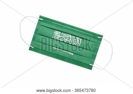 Medical Mask With Flag Of Saudi Arabia Isolated On White Background. Saudi Arabia Pandemic Concept.