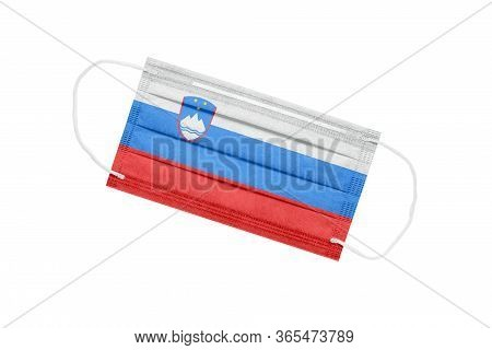 Medical Mask With Flag Of Slovenia Isolated On White Background. Slovenia Pandemic Concept. Coronavi
