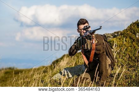 Hunter Man. Shooter Sighting In The Target. Hunting Period. Male With A Gun. Close Up. Hunter With H