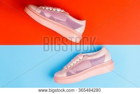 Overhead Shot Of Running Shoes. Sneakers Isolated On Blue Background, Fashion. Sport Shoes. Pair Of