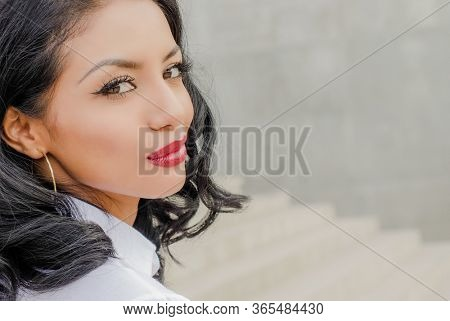 Young woman's face looking to side with copy space.