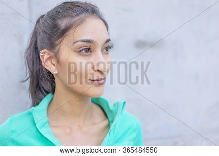 Young woman wearing active wear looking to side