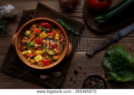 Chopped Cooked Vegetables On Dark Wood. Traditional Ratatouille With Zucchini, Bell Pepper And Eggpl