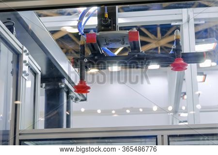Close Up View Of Automatic Pick And Place Robotic Arm Manipulator With Suction Cups - Part Of Plasti