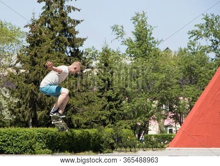 Moscow, Russia-09.05.2020:the Guy Shows Extreme Tricks And Jumps On A Skateboard In The City. Skateb