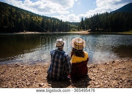 Travelers Couple Admire View Of Mountain Lake. Travel And Active Life Concept. Adventure And Travel