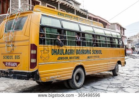 Jomsom, Nepal - November 19, 2015: Children Riding A School Bus To School In The Early Morning In Jo