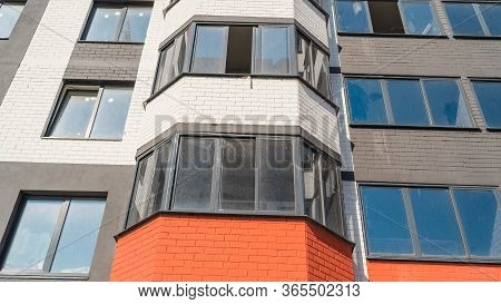 Modern Beautiful New Buildings. Colored Wall, Modern Apartment Buildings On A Sunny Day. Facade Of A