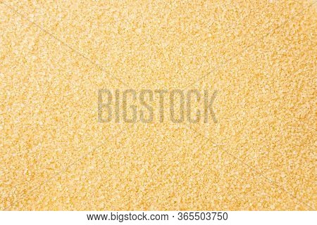 Heap Of Cane Sugar. Top View. Background Of Brown Sugar. Dark Sugar Background. Sugar For Cooking. S