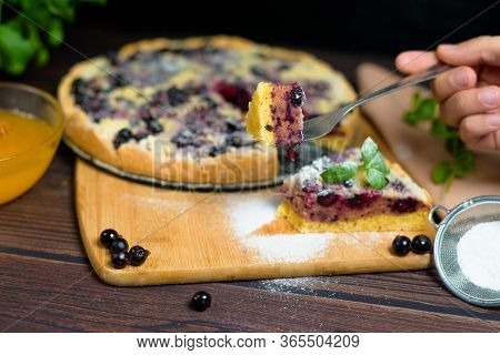 Pie With Black Currant And Shortbread, Fresh Berries. The Pie Is Cut Into Pieces And The Top Is Spri