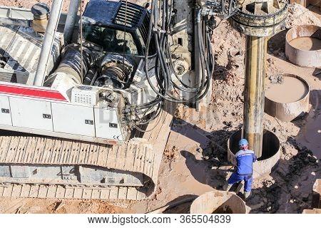 Kirishi, Russia - 8 May, Worker Monitors The Progress Of Drilling, 8 May, 2020. Start Of Constructio