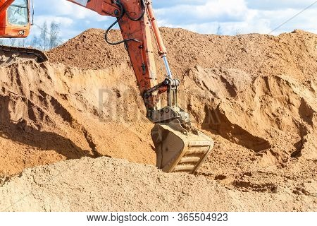 Kirishi, Russia - 8 May, Work Bucket On A Pile Of Sand, 8 May, 2020. Start Of Construction Of A Moto
