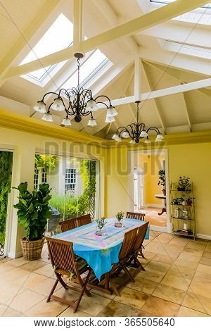 Inside Interior Of Dining Room With Skylight Conservatory Roof In Up-market House In The Suburbs
