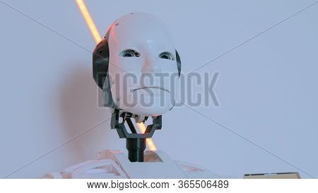White Humanoid Robot Head At Technology Exhibition. Future And Robotic Concept