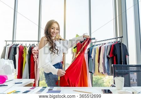 Woman Fashion Designer Smile And Using Tape For Measuring Mannequin Creating Pret-a-porter Collectio