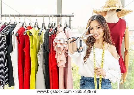 Portrait Of Asian Woman Fashion Designer Standing Smiling With Holding Show Scissors At The Designer
