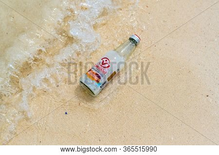 Koh Lipe, Thailand - 13.11.2019: Empty Glass From Limonade Drink Is Placed On Sand Beach Near Sea, A