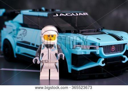 Tambov, Russian Federation - February 19, 2020 Lego Jaguar I-pace Etrophy Car And Driver Minifigure