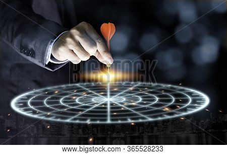 Businessman Throwing Red Arrow Dart To Virtual Target Dart Board. Setup Objectives And Target For Bu