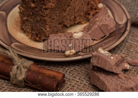Chocolate Bar Pieces. Background With Chocolate. Sweet Food Photo Concept. The Chunks Of Broken Choc