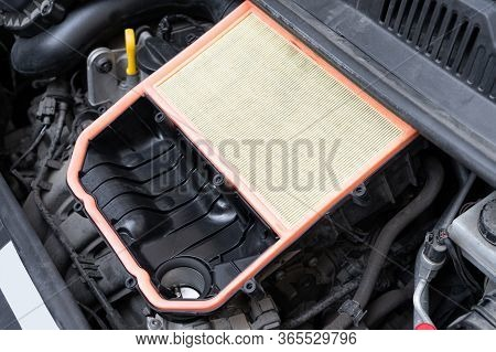 Open Air Box With New Filter In Car Engine Bay. Mechanic Repair Or Vehicle Maintenance Concept.