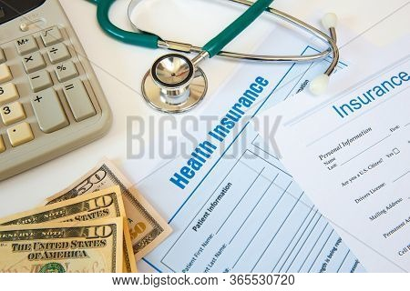 Health Insurance With Insurance Claim Form And Stethoscope. Health Insurance Concept
