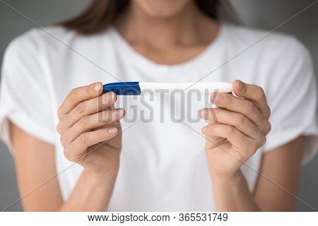Close Up View Female Hands Holding Pregnancy Or Ovulation Test