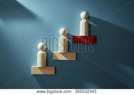 Career Growth. Career Development. Goal Achievement. Career Path. Wooden Figure Placed In Increasing