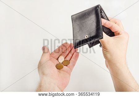 Male Hand Opening A Wallet And Count Coins (money) On White Background. World Economic Crisis. Finan