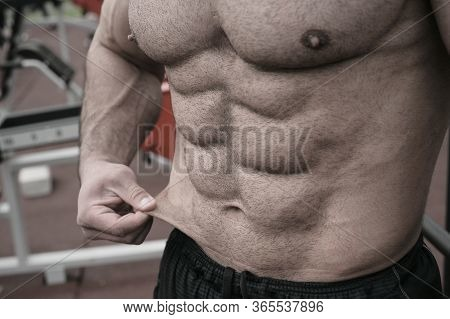 Body Fat Weight Loss Sport Nutrition Concept On Strong Young Man With Perfect Body Physique Abdomina