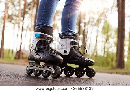 Close Up Picture Of Rollerblades, Unknown Person Wearing Rollerskates To Spend Time Actively, Black