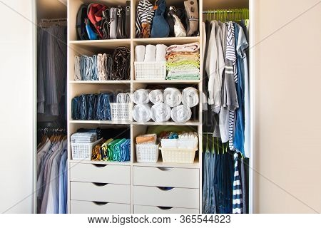 Clothing Lying In The Drawer In The Wardrobe. T-shirts For Women. The Order In The Wardrobe. Beige W