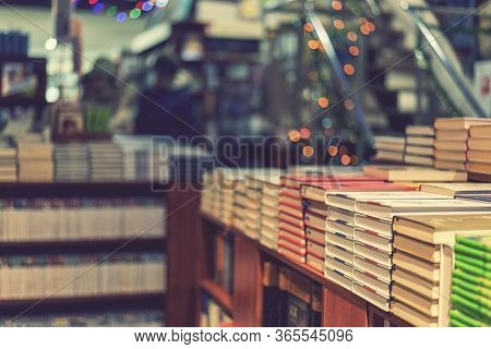 Image Of Abstract Blur People At Book Store In Shopping Mall For Background Usage. Toned