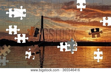 Assorted Jigsaw Puzzle Of The Silhouette Of A Cable-stayed Bridge In Riga Against A Beautiful Sunset