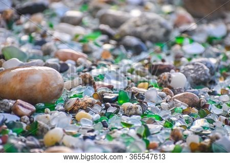 Shells, Stones And Crystals Rounded By The Erosion Of The Sea Los Cristales Beach, Galicia. Spain.