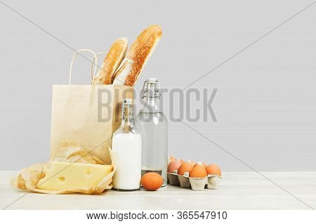 Two French Baguette Bread Loafs In Mockup Plain Paper Bag With Dairy Produce, Eggs Cheese Water Milk